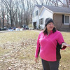 JOHN KLINE | THE GOSHEN NEWS<br /> Lisa Sluder, 30874 Creekwood Terrace, Osceola, talks about the experience of having to be evacuated from her neighborhood due to last week's major flooding event while taking a break from cleaning out her soggy basement Tuesday afternoon.