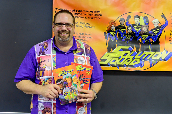 "BEN MIKESELL | THE GOSHEN NEWS<br /> North Side Middle School math teacher Jim McClain has spent years working on his math-themed comic book, ""Solution Squad,"" which he uses in his classroom to teach math concepts. McClain created each of the characters in the hero group, which personify various math symbols."