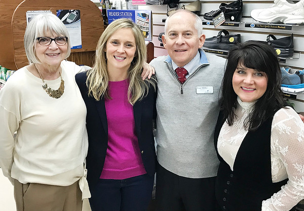 JOHN KLINE | THE GOSHEN NEWS<br /> From left, Morag Miller poses with daughter Beth Stutz, husband Tom Miller and daughter Emily Marshall during the Millers' retirement open house at the Topeka Pharmacy Saturday morning.