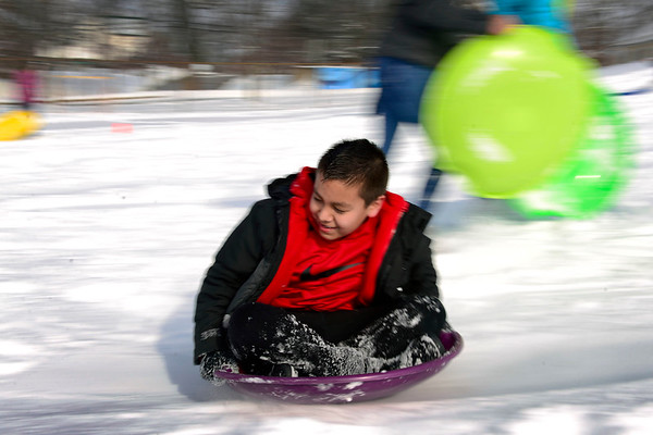 BEN MIKESELL | THE GOSHEN NEWS<br /> Chamberlain Elementary fifth-grader Erick Hernandez speeds down the sledding hill during recess Wednesday at Chamberlain.