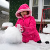 BEN MIKESELL | THE GOSHEN NEWS<br /> Miranda Perkins, 11, works on making a snowman Friday afternoon in the front yard of her house on Madison Street in Goshen.