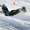 BEN MIKESELL | THE GOSHEN NEWS<br /> Avery Fowler, fifth-grader at Chamberlain Elementary School, crashes into a pile of snow while sledding with classmates during recess Wednesday at Chamberlain.