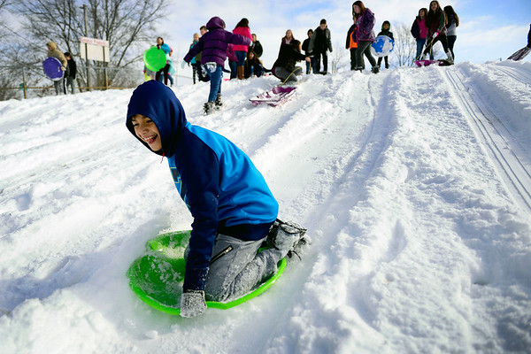 BEN MIKESELL | THE GOSHEN NEWS<br /> Bryan Diaz-De Leon, fifth-grader at Chamberlain Elementary School, speeds down the sledding hill during recess with his classmates Wednesday at Chamberlain. Students took turns racing down the hill, and at the end of the period they cheered as their teachers each took turns as well.