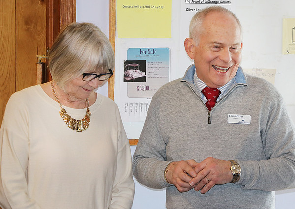 JOHN KLINE | THE GOSHEN NEWS<br /> From left, Morag and Tom Miller, retiring owners of the Topeka Pharmacy, chat with attendees during their retirement open house at the Crossroads Café within the pharmacy building in downtown Topeka Saturday morning.