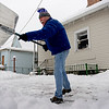 "BEN MIKESELL | THE GOSHEN NEWS<br /> Jay Troyer shovels out the driveway behind his home Friday afternoon on 7th Street in Goshen. ""It's sort of a Sisyphean task, knowing I'll have to shovel again in a few hours,"" Troyer said jokingly. Snow is expected to fall in Elkhart County throughout the weekend."