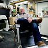 BEN MIKESELL | THE GOSHEN NEWS<br /> Rob Drake sits in his lounging chair at his business, Rob's Barber Shop, in Bristol. Drake bought his barber shop from his mentor Don Shock at the age of 18, after Shock agreed to sell him the shop when Drake completed barber school.