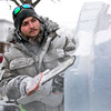BEN MIKESELL | THE GOSHEN NEWS<br /> Josh Niven of Buchanan, Mich. carves details into his royal throne ice sculpture Friday for the Fire and Ice Festival in downtown Goshen.