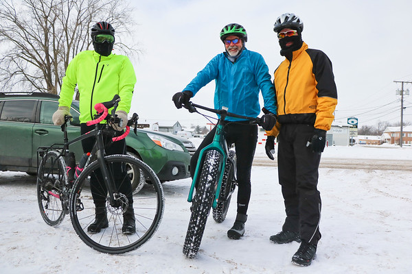 LEANDRA BEABOUT | THE GOSHEN NEWS<br /> Goshen residents Eric Selner, Jud Gingrich and David Kay wait outside Lincoln Avenue Cycling for the third annual Ice Cycle to begin.