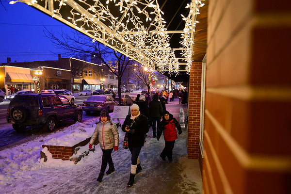 BEN MIKESELL | THE GOSHEN NEWS<br /> People walk along Main St. viewing ice sculptures during the Fire and Ice Festival on Friday in Goshen.