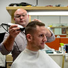 "BEN MIKESELL | THE GOSHEN NEWS<br /> Jason Pestow of Bristol lets Rob Drake cut his hair Thursday at Rob's Barber Shop in Bristol. Pestow has been coming to the barber shop for four months. ""I'd rather be spending money at local places like Rob's than corporate places,"" Pestow said."