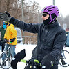 LEANDRA BEABOUT | THE GOSHEN NEWS<br /> Steve Peterson, Elkhart, helps direct fellow cyclists as they wait for the third annual Ice Cycle to begin.