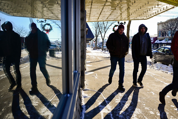 BEN MIKESELL | THE GOSHEN NEWS<br /> Matt Maskill of Nappanee walks with Jon Savage of Goshen walk through downtown Goshen in near zero temperatures Tuesday afternoon. Early morning temperatures reached a record low of minus 15 degrees.