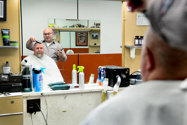 BEN MIKESELL | THE GOSHEN NEWS<br /> Rob Drake cuts Bob Pettit's hair Thursday at Rob's Barber Shop in Bristol. Pettit lives in Bristol and has let Drake cut his hair for 18 years.