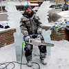 BEN MIKESELL | THE GOSHEN NEWS<br /> Josh Niven of Buchanan, Mich. tests out his royal throne ice sculpture Friday for the Fire and Ice Festival in downtown Goshen.