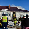 BEN MIKESELL | THE GOSHEN NEWS<br /> Foraker and New Paris fire departments respond to a house fire at 71042 C.R. 19 on Tuesday in New Paris.