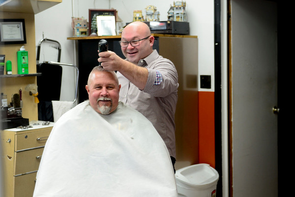 BEN MIKESELL | THE GOSHEN NEWS<br /> Bob Pettit of Bristol laughs with barber Rob Drake on Thursday at Rob's Barber Shop in Bristol. Pettit has been coming to the barber shop for 18 years, since Drake opened his shop.
