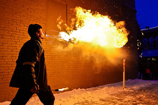 BEN MIKESELL | THE GOSHEN NEWS<br /> Luke Hanna of Stowe, Vermont, breathes fire for the crowd gathered for the Fire and Ice Festival on Friday in downtown Goshen. Hanna is originally from Goshen, and has been working with fire since 2014.