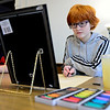 BEN MIKESELL | THE GOSHEN NEWS<br /> Kali Hartman, 14, focuses on her self portrait during the Exploring Pastels class Wednesday at Goshen Youth Arts.