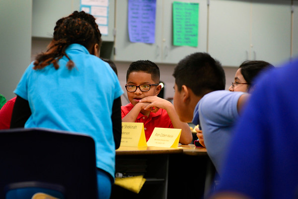 BEN MIKESELL | THE GOSHEN NEWS<br /> Diego Salgado, fourth-grader at West Goshen Elementary School, collaborates with classmates while learning about saturated and unsaturated fats in Jennifer Camacho's class Wednesday as part of West Goshen's Healthy Hearts program.