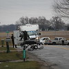 AIMEE AMBROSE | <br /> THE GOSHEN NEWS<br /> Lt. Doug Rybeck of the Elkhart Police Department's bomb squad suited up in bomb armor to move a pipe bomb from a yard at 18303 C.R. 42 and into a field after the unit's bomb robot had a wheel malfunction during hte operation Monday.