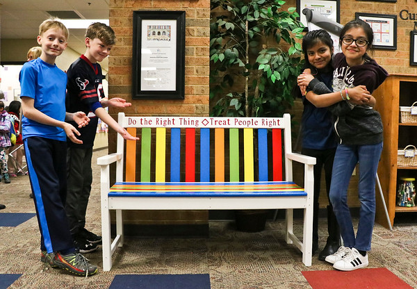 "LEANDRA BEABOUT | THE GOSHEN NEWS<br /> Fifth-graders Brady Wiese, Crosby Poling-Braun, Heidy Tecpil Ramos and Jessica Ramos-Morales show off Parkside Elementary School's new ""buddy bench."""