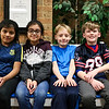 "LEANDRA BEABOUT | THE GOSHEN NEWS<br /> Fifth-graders Heidy Tecpil Ramos, 10, Jessica Ramos-Morales, 11, Brady Wiese, 10, and Crosby Poling-Braun, 11, sit on Parkside Elementary School's new ""buddy bench."""