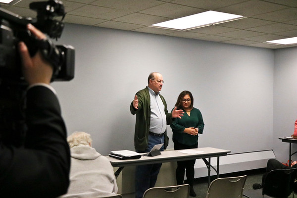 LEANDRA BEABOUT | THE GOSHEN NEWS<br /> Dwight Fish, member of Elkhart City Council representing District 4, and Justice Without Borders member Patty Gorostieta presented information about Elkhart's ID card initiative to community members at the Elkhart Public Library.