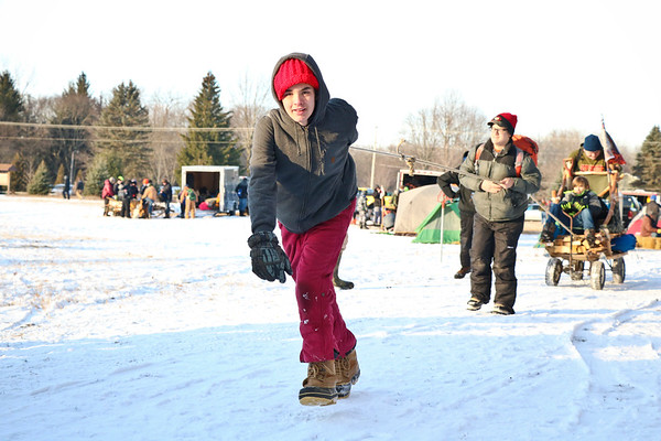 LEANDRA BEABOUT | THE GOSHEN NEWS<br /> Wyatt Newcomer helps pull a sled for Troop 12 in the 2018 Klondike Derby.