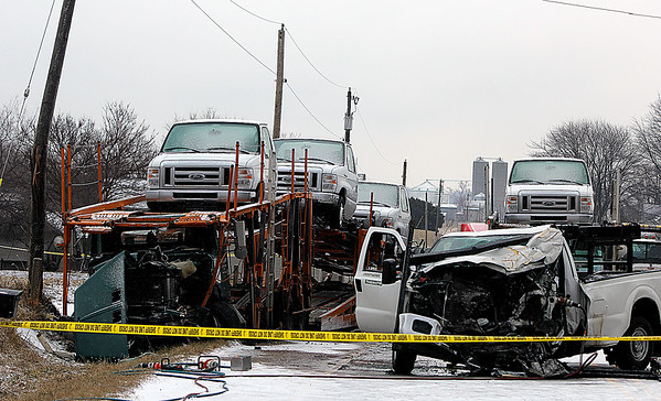 AIMEE AMBROSE | THE GOSHEN NEWS<br /> One person died in a head-on crash involving a pickup truck and a tractor trailer hauling vehicles at U.S. 6 and C.R. 25 near New Paris Wednesday morning.