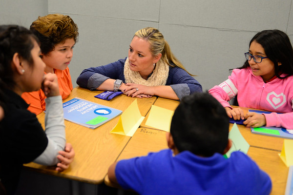 BEN MIKESELL | THE GOSHEN NEWS<br /> West Goshen Elementary teacher Jennifer Camacho converses with her fourth-grade students as they come up with an answer during Barbara Welty's trivia game Wednesday as part of the Northern Indiana Hispanic Health Coalition's Healthy Hearts program.