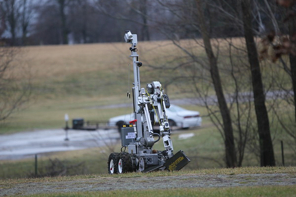 AIMEE AMBROSE | <br /> THE GOSHEN NEWS<br /> The Elkhart Police Department's bomb squad robot used a mounted disruptor to disable a pipe bomb found in the yard of a home at 18303 C.R. 42 in Goshen Monday. The bomb was crippled in a field away from homes along the road.