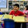 BEN MIKESELL | THE GOSHEN NEWS<br /> West Goshen Elementary fourth-grader Jareth Palacios-Sanchez smiles as he answers a question during the Northern Indiana Hispanic Health Coalition's Healthy Hearts program Wednesday at West Goshen.