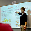 "BEN MIKESELL | THE GOSHEN NEWS<br /> Barbara Welty with the Elkhart County Health Department explains the difference between unsaturated and saturated fats to Jennifer Camacho's fourth grade class Wednesday at West Goshen Elementary School. ""The best time to learn about eating healthy is now,"" Welty said. She has been working with the Northern Indiana Hispanic Health Coalition to teach students about the Healthy Hearts program, which seeks to combat childhood obesity in area schools."