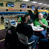 BEN MIKESELL | THE GOSHEN NEWS<br /> Rick Holderread from First State Bank chats with coworkers while waiting his turn to bowl at the 10th annual Spare Time with the Chamber event Thursday at Maple City Bowl.