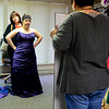BEN MIKESELL | THE GOSHEN NEWS<br /> Faith Nickel from Elkhart receives help from her mother Stacey while trying on a dress Saturday at ADEC Inc. in Bristol.