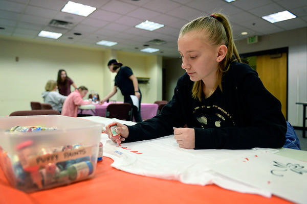 BEN MIKESELL | THE GOSHEN NEWS<br /> Twelve-year-old Leah Housholder from Goshen uses puffy paint to draw hearts on a shirt Monday at the Goshen Public Library. The Maker Monday occurs once a month, and gives students an opportunity to try making different crafts.