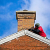 BEN MIKESELL | THE GOSHEN NEWS<br /> Imrich Kuric, owner of I-Fix-Bricks, flashes a chimney Tuesday afternoon at 101 N 3rd St. in Goshen.