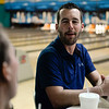 BEN MIKESELL | THE GOSHEN NEWS<br /> Andy Wolf with Salem Insurance chats with coworkers while waiting for his turn to bowl at the 10th annual Spare Time with the Chamber event Thursday at Maple City Bowl.