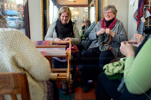 BEN MIKESELL | THE GOSHEN NEWS<br /> To embody February's First Friday theme of coziness, Jan Clark of Elkhart and Janey Brookmeyer of Goshen gathered with other women in the window of Reverie Yarn Decor & Gifts to knit and watch people walk down Main Street.