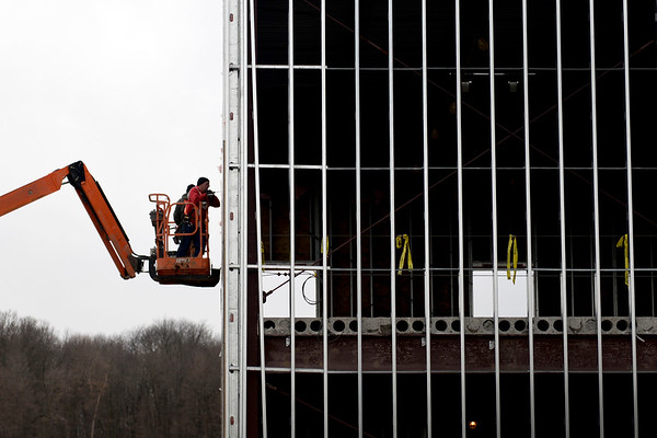 BEN MIKESELL | THE GOSHEN NEWS<br /> Construction workers make progress on the expansions at Grace Community Church on Wednesday. The four-stage expansion of community spaces and student recreation areas is planned to be finished in May.