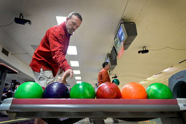 BEN MIKESELL | THE GOSHEN NEWS<br /> Del Troyer with Greenfield Landscape Services reaches for a bowling ball during the 10th annual Spare Time with the Chamber event Thursday at Maple City Bowl. Troyer has been bowling at the event since its inaugural year.