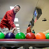 BEN MIKESELL   THE GOSHEN NEWS<br /> Del Troyer with Greenfield Landscape Services reaches for a bowling ball during the 10th annual Spare Time with the Chamber event Thursday at Maple City Bowl. Troyer has been bowling at the event since its inaugural year.