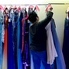 BEN MIKESELL | THE GOSHEN NEWS<br /> Jessica Koscher, Chief Development Officer with ADEC Inc., adjusts the dress rack during Dress Day on Saturday at ADEC in Bristol.