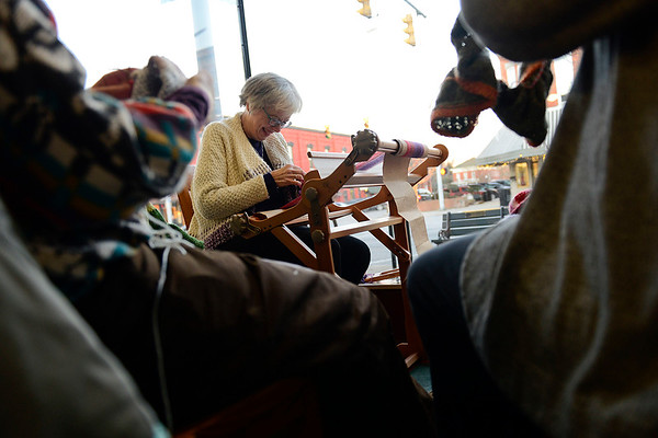BEN MIKESELL | THE GOSHEN NEWS<br /> Trish Habegger laughs while weaving with other women in the window of Reverie Yarn Decor & Gifts for First Friday.