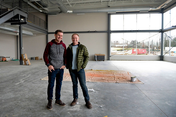 "BEN MIKESELL | THE GOSHEN NEWS<br /> Pastors Jim Brown and Jon Rauch stand inside what will be the new children's playground Wednesday at Grace Community Church in Goshen. ""The Park"" will be free and open to the public when it opens in March."
