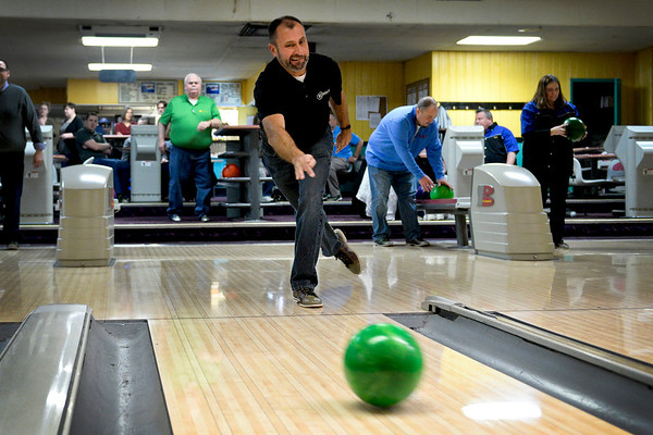"BEN MIKESELL | THE GOSHEN NEWS<br /> Brent Carrick with First State Bank sends the ball down the lane Thursday during The Goshen Chamber of Commerce's 10th annual Spare Time with the Chamber at Maple City Bowl. The outing brings together different businesses around Goshen to network and compete for the best score. ""We look forward to it every year,"" Carrick said. ""We've been coming since the beginning."""