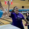 BEN MIKESELL   THE GOSHEN NEWS<br /> Tessie Molina highfives her coworker Brad Humsberger from La Casa Inc. after bowling a strike during the 10th annual Spare Time with the Chamber event Thursday at Maple City Bowl. This was Molina's first year participating in the event.