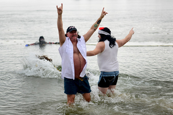 BEN MIKESELL   THE GOSHEN NEWS<br /> Jason Miller from Syracuse motions to the crowd as he walks into Lake Wawasee for the Fire and Ice Polar Plunge at The Oakwood Resort in Syracuse.