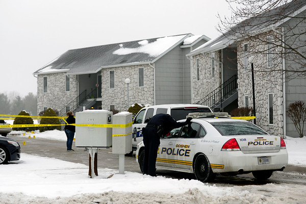 BEN MIKESELL | THE GOSHEN NEWS<br /> Goshen Police stay on the scene of a shooting Tuesday morning at Country Place Condominiums on the corner of West Clinton Street and Tanglewood Drive in Goshen. The shooting took place at 4:24 a.m. in the parking lot of the complex.
