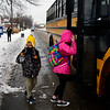 BEN MIKESELL | THE GOSHEN NEWS<br /> Josh Adomokai, 7, waves to his father Clem while getting on the bus to Chandler Elementary School Monday in Goshen. Goshen Community Schools were on a two-hour delay due to poor weather conditions.